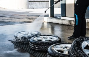 Cleaning car tires.